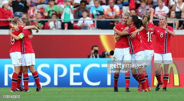 Ada Hegerberg of Norway celebrate with team mate Cathrine Dekkerhus after the UEFA Women's Euro 2013 group B match between Germany and Norway at...