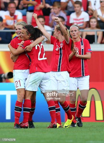 Ada Hegerberg of Norway celebrate with team mate Cathrine Dekkerhus after the UEFA Women's Euro 2013 group B match between Germany and Norway at...