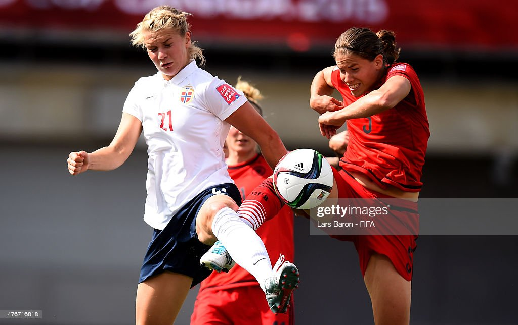 Ada Hegerberg of Norway is challenged by Annike Krahn of Germany during the FIFA Women's World Cup 2015 Group B match between Germany and Norway at...