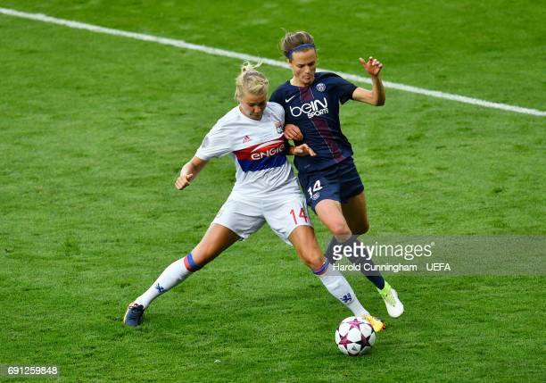 Ada Hegerberg of Olympique Lyonnais and Irene Paredes of Paris SaintGermain Feminines battle for the ball during the UEFA Women's Champions League...