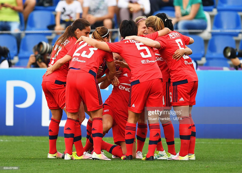 Ada Hegerberg of Olympique Lyonnais (obscured) celebrates with team mates as she scores their first goal during the UEFA Women's Champions League Final match between Wolfsburg and Lyon at Stadio Citta del Tricolore on May 26, 2016 in Reggio nell'Emilia, Italy.