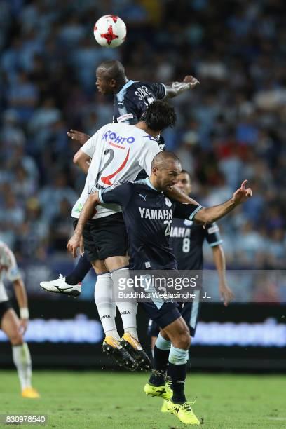 Adailton of Jubilo Iwata and Genta Miura of Gamba Osaka compete for the ball during the JLeague J1 match between Gamba Osaka and Jubilo Iwata at...