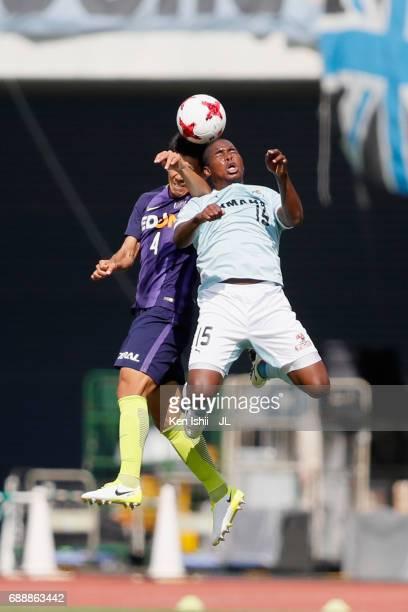 Adailton of Jubilo Iwata and Hiroki Mizumoto of Sanfrecce Hiroshima compete for the ball during the JLeague J1 match between Sanfrecce Hiroshima and...