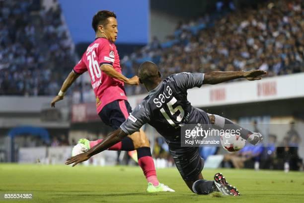 Adailton of Jubilo Iwata and Kota Mizunuma of Cerezo Osaka compete for the ball during the JLeague J1 match between Jubilo Iwata and Cerezo Osaka at...