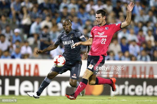 Adailton of Jubilo Iwata and Matej Jonjic of Cerezo Osaka compete for the ball during the JLeague J1 match between Jubilo Iwata and Cerezo Osaka at...