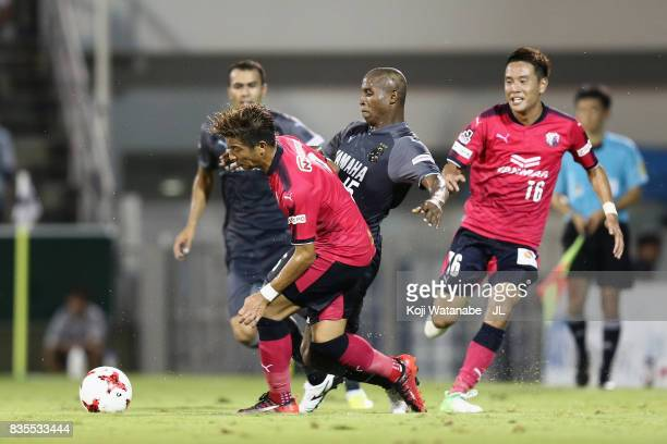 Adailton of Jubilo Iwata and Riku Matsuda of Cerezo Osaka compete for the ball during the JLeague J1 match between Jubilo Iwata and Cerezo Osaka at...