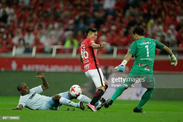 Adailton of Jubilo Iwata competes for the ball against Ryota Moriwaki and Shusaku Nishikawa of Urawa Red Diamonds during the JLeague J1 match between...