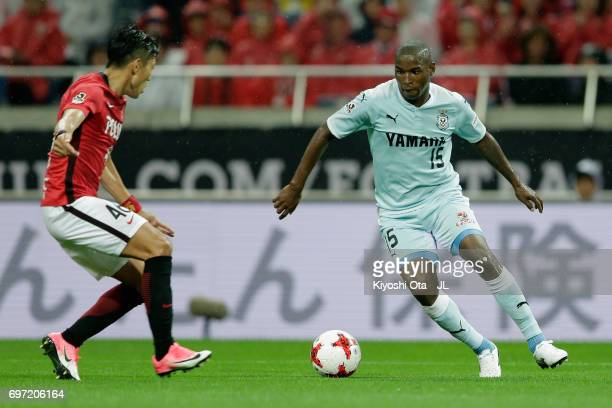 Adailton of Jubilo Iwata goes past Ryota Moriwaki of Urawa Red Diamonds to score his side's second goal during the JLeague J1 match between Urawa Red...