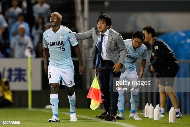 Adailton of Jubilo Iwata is congratulated by head coach Hiroshi Nanami after scoring his side's second goal with his team mates during the JLeague J1...