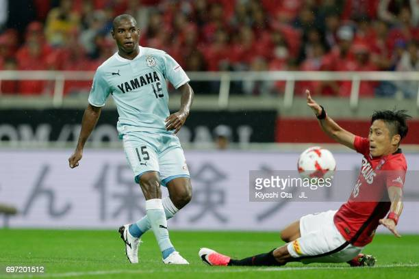 Adailton of Jubilo Iwata scores his side's second goal past Ryota Moriwaki of Urawa Red Diamonds during the JLeague J1 match between Urawa Red...