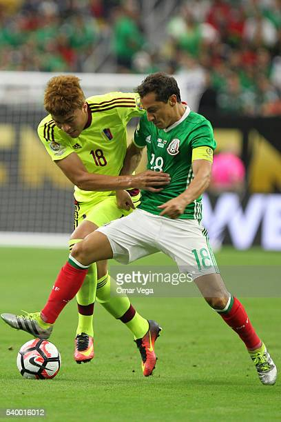Adalberto Peñaranda of Venezuela and Andres Guardado of Mexico fight for the ball during a group C match between Mexico and Venezuela at NRG Stadium...