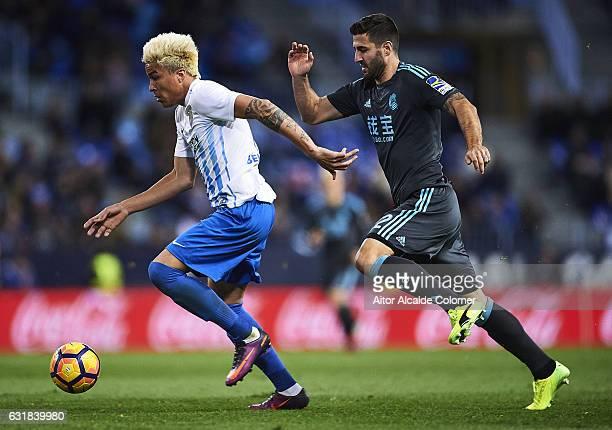 Adalberto Penaranda of Malaga CF being followed by Raul Rodriguez Navas of Real Sociedad during the La Liga match between Malaga CF and Real Sociedad...