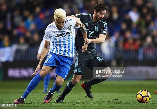 Adalberto Penaranda of Malaga CF competes for the ball with Esteban Granero of Real Sociedad during the La Liga match between Malaga CF and Real...