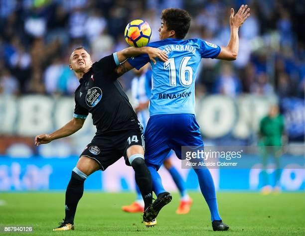 Adalberto Penaranda of Malaga CF competes for the ball with Stanislav Lobotka of Celta de Vigo during the La Liga match between Malaga and Celta de...