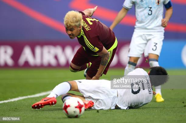 Adalberto Penaranda of Venezuela beats a challenge from Takehiro Tomiyasu of Japan during the FIFA U20 World Cup Korea Republic 2017 Round of 16...