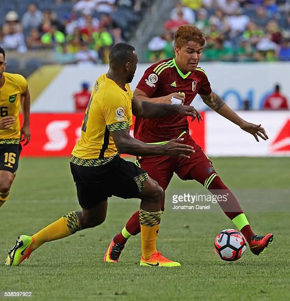 Adalberto Penaranda of Venezuela challenges Wes Morgan of Jamaica during a match in the 2016 Copa America Centenario at Soldier Field on June 5 2016...
