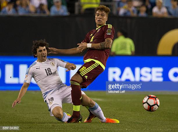 Adalberto Penaranda of Venezuela collides with Martias Corujo of Uruguay during the 2016 Copa America Centenario Group C match at Lincoln Financial...