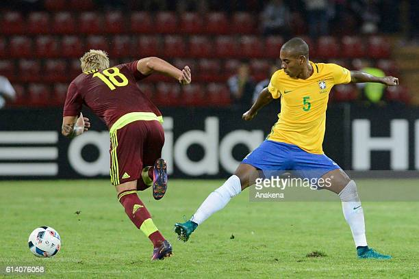 Adalberto Penaranda of Venezuela dribbles past Fernandinho of Brazil during a match between Venezuela and Brazil as part of FIFA 2018 World Cup...