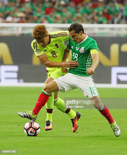 Adalberto Penaranda of Venezuela fights for the ball with Andres Guardado of Mexico during the 2016 Copa America Centenario Group match between...