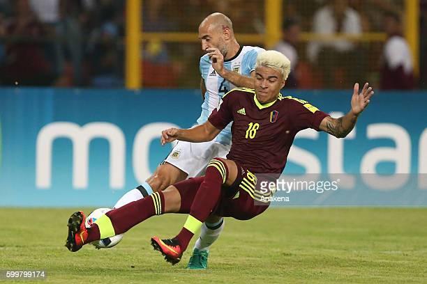 Adalberto Penaranda of Venezuela fights for the ball with Pablo Zabaleta of Argentina during a match between Venezuela and Argentina as part of FIFA...
