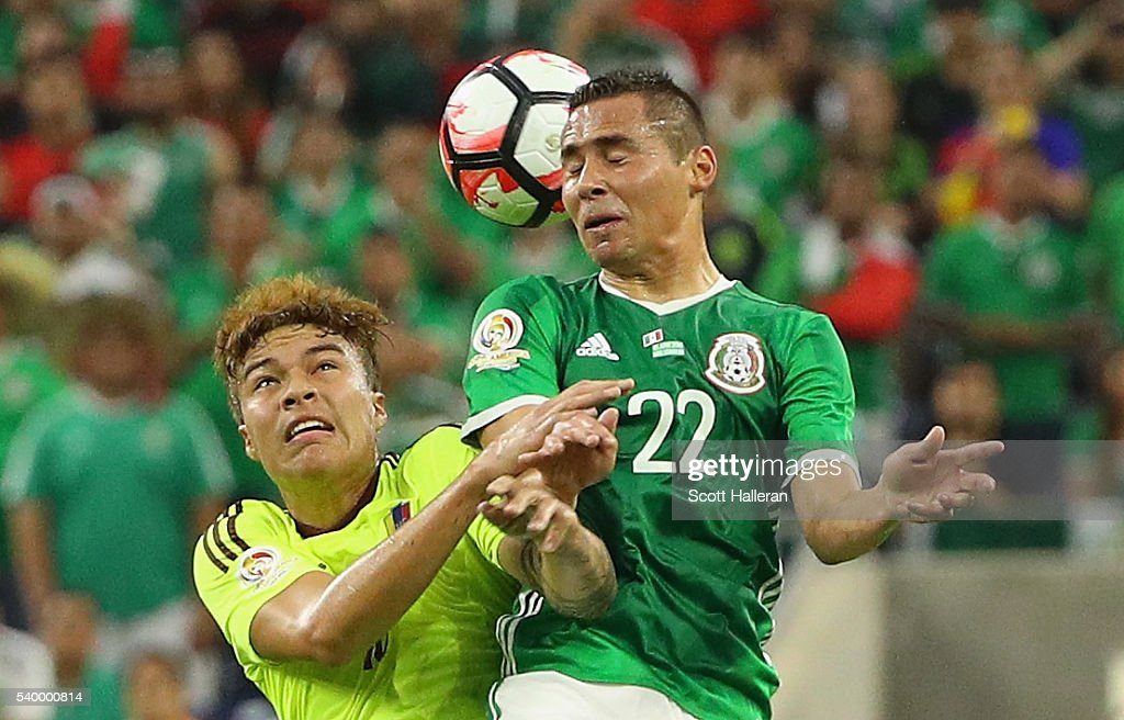 Adalberto Penaranda #18 of Venezuela fights for the ball with <a gi-track='captionPersonalityLinkClicked' href=/galleries/search?phrase=Paul+Aguilar&family=editorial&specificpeople=4476672 ng-click='$event.stopPropagation()'>Paul Aguilar</a> #22 of Mexico during the 2016 Copa America Centenario Group match between Mexico and Venezuela at NRG Stadium on June 13, 2016 in Houston, Texas.