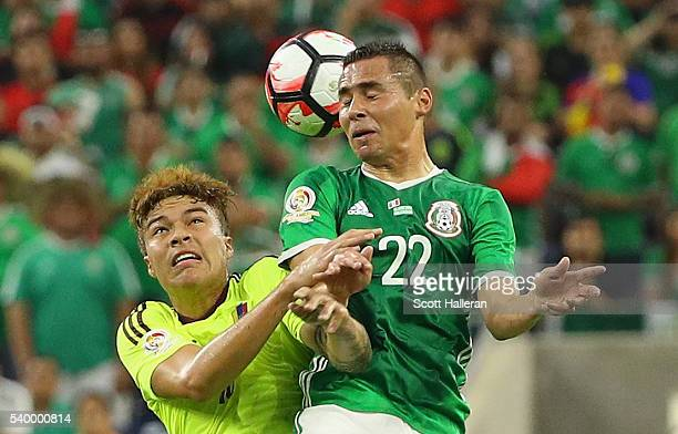 Adalberto Penaranda of Venezuela fights for the ball with Paul Aguilar of Mexico during the 2016 Copa America Centenario Group match between Mexico...