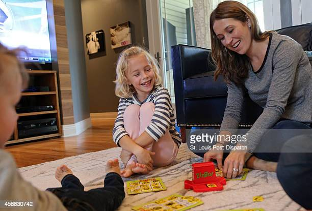 Adali Antisdel plays a board game called Zingo with her mother Jamie Antisdel and the rest of her family on Sunday Nov 9 in Sunset Hills Mo Adali was...