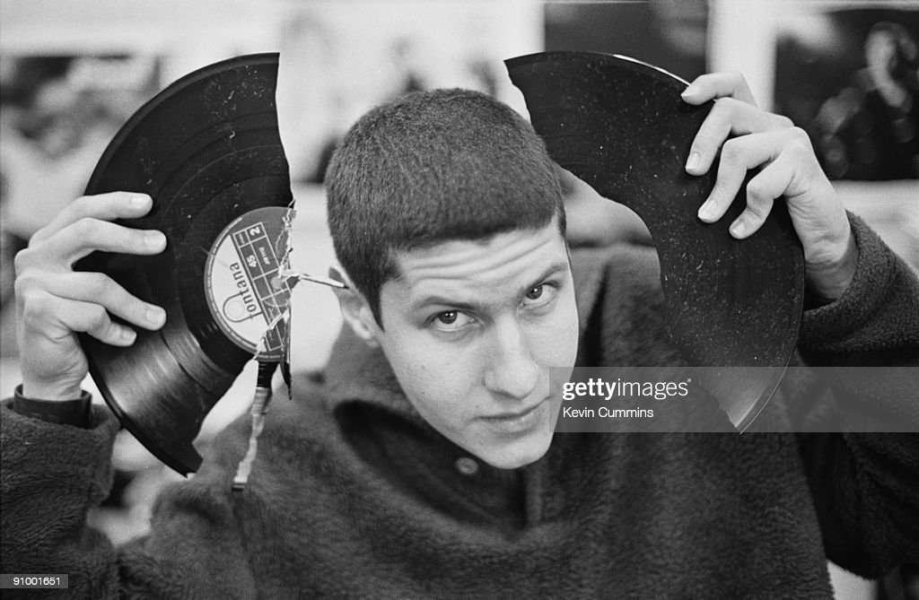 Adam Ad-Rock' Horovitz, of American hip-hop group the Beastie Boys holding a broken 12-inch single during a session as guest reviewer of the latest releases, 1992.