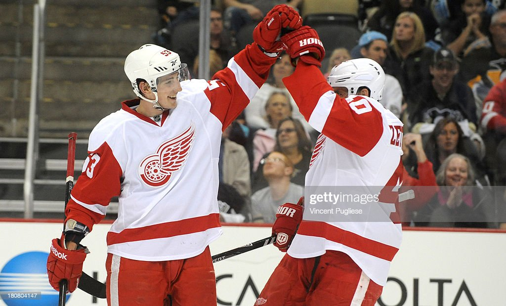 Adam Almquist #53 of the Detroit Red Wings is congratulated by <a gi-track='captionPersonalityLinkClicked' href=/galleries/search?phrase=Henrik+Zetterberg&family=editorial&specificpeople=201520 ng-click='$event.stopPropagation()'>Henrik Zetterberg</a> #40 after his goal during the second period of a preseason game on September 16, 2013 at the CONSOL Energy Center in Pittsburgh, Pennsylvania.
