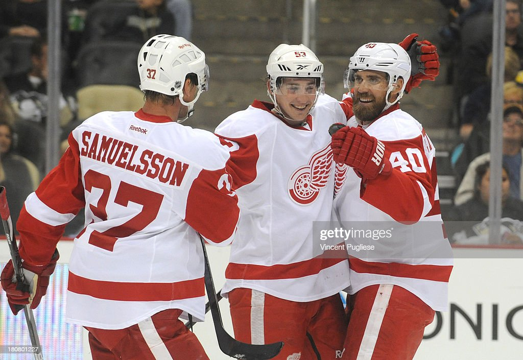 Adam Almquist #53 of the Detroit Red Wings is congratulated by teammates <a gi-track='captionPersonalityLinkClicked' href=/galleries/search?phrase=Mikael+Samuelsson&family=editorial&specificpeople=203085 ng-click='$event.stopPropagation()'>Mikael Samuelsson</a> # 37 and <a gi-track='captionPersonalityLinkClicked' href=/galleries/search?phrase=Henrik+Zetterberg&family=editorial&specificpeople=201520 ng-click='$event.stopPropagation()'>Henrik Zetterberg</a> #40 after his goal during the second period of a preseason game on September 16, 2013 at the CONSOL Energy Center in Pittsburgh, Pennsylvania.