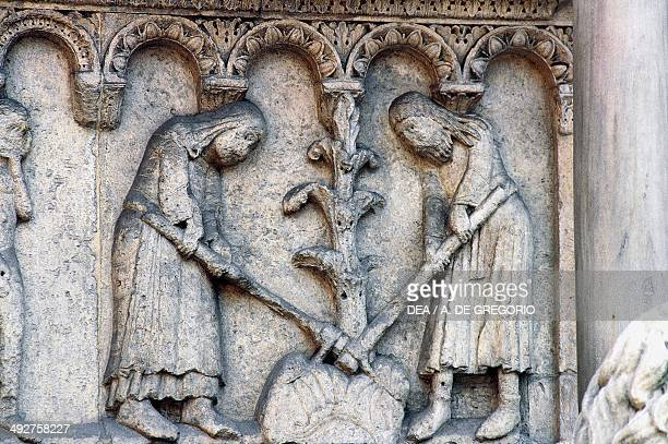 Adam and Eve are forced to work in the fields detail from Stories of Genesis 12th century by Wiligelmus marble basrelief facade of Modena Cathedral...