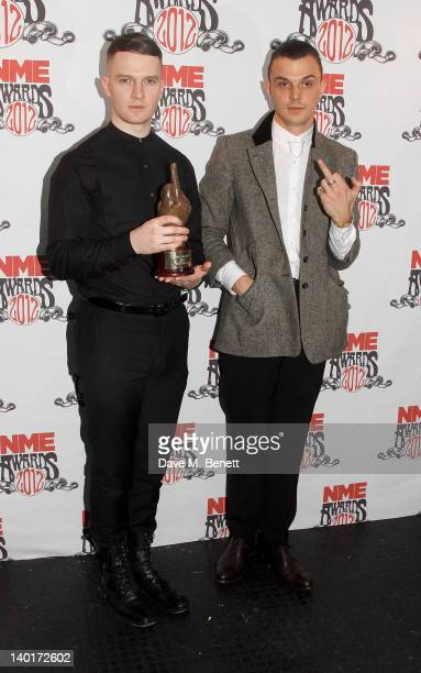 Adam Anderson and Theo Hutchcraft of Hurts pose in front of the winners boards with the award for Best Video at the NME Awards 2012 held at the...
