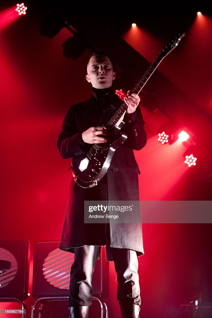 Adam Anderson of Hurts performs on stage at Manchester Apollo on October 25, 2013 in Manchester, England.