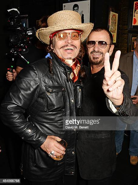Adam Ant and Ringo Starr attend as John Varvatos launch their first European store in London on September 3 2014 in London England