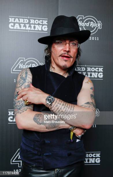Adam Ant poses for portraits in the Hard Rock Cafe VIP Tent during the third and final day of Hard Rock Calling at Hyde Park on June 26 2011 in...