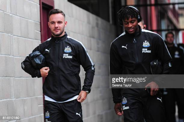 Adam Armstrong and Rolando Aarons of Newcastle arrives for the PreSeason Friendly between Heart of Midlothian and Newcastle United at the Tynecastle...