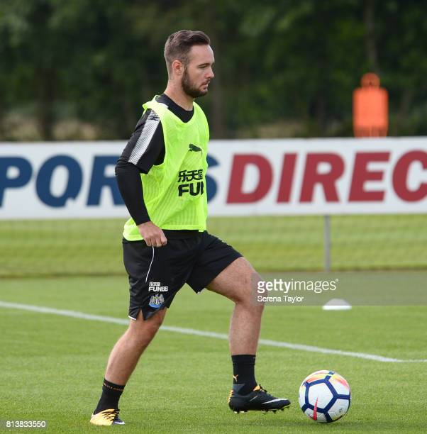 Adam Armstrong controls the ball during the Newcastle United Training session at the Newcastle United Training Centre on July 13 in Newcastle upon...