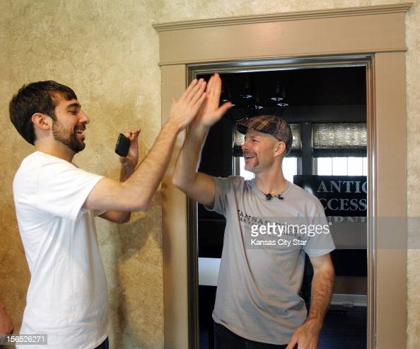 Adam Arredondo CEO and Matthew Marcus CTO of Local Ruckus a Hanover Heights fiberhood in Kansas City Kansas high five near the completion of the...