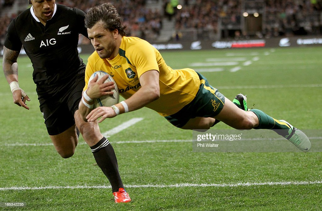 Adam Ashley Cooper of the Wallabies scores a try during The Rugby Championship match between the New Zealand All Blacks and the Australian Wallabies at Forsyth Barr Stadium on October 19, 2013 in Dunedin, New Zealand.