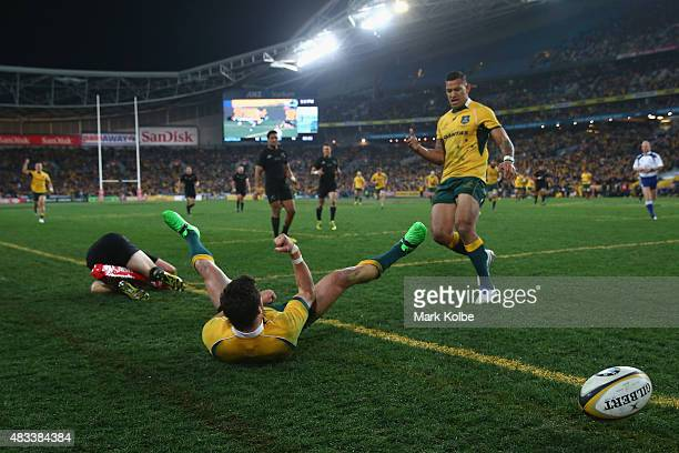 Adam AshleyCooper and Israel Folau of the Wallabies celebrate after Adam AshleyCooper scored a try during The Rugby Championship match between the...