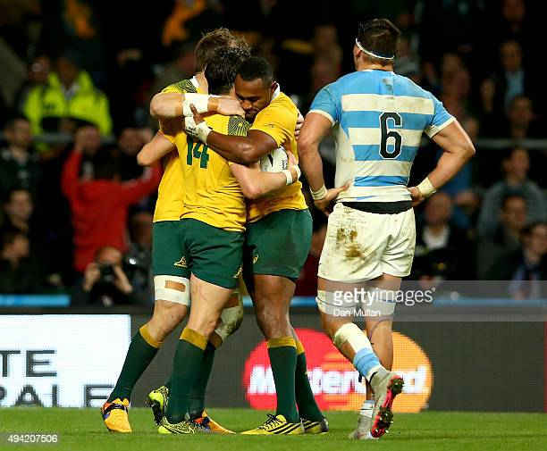 Adam AshleyCooper celebrates with teammates after scoring his third try during the 2015 Rugby World Cup Semi Final match between Argentina and...
