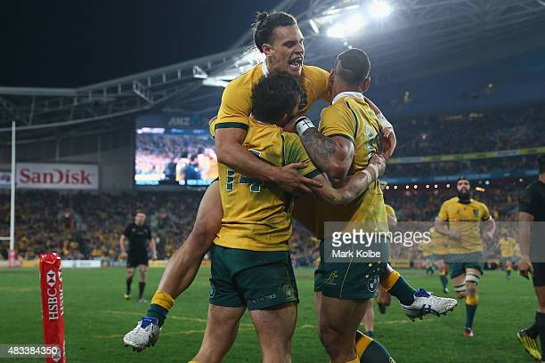 Adam AshleyCooper Matt Toomua and Israel Folau of the Wallabies celebrate after Adam AshleyCooper scored a try during The Rugby Championship match...