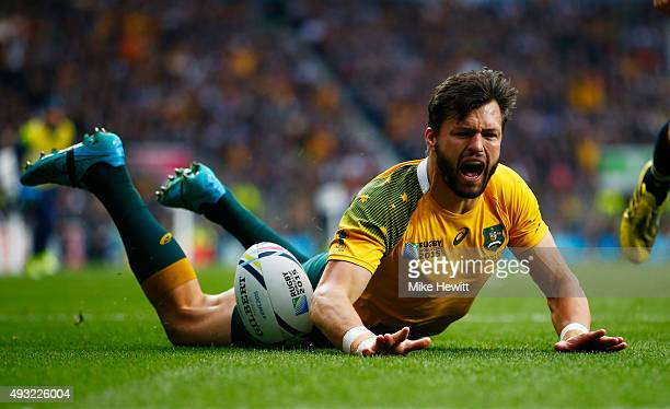 Adam AshleyCooper of Australia celebrates scoring his teams opening try during the 2015 Rugby World Cup Quarter Final match between Australia and...
