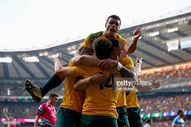 Adam AshleyCooper of Australia celebrates with teammates after scoring his sides second try during the 2015 Rugby World Cup Semi Final match between...