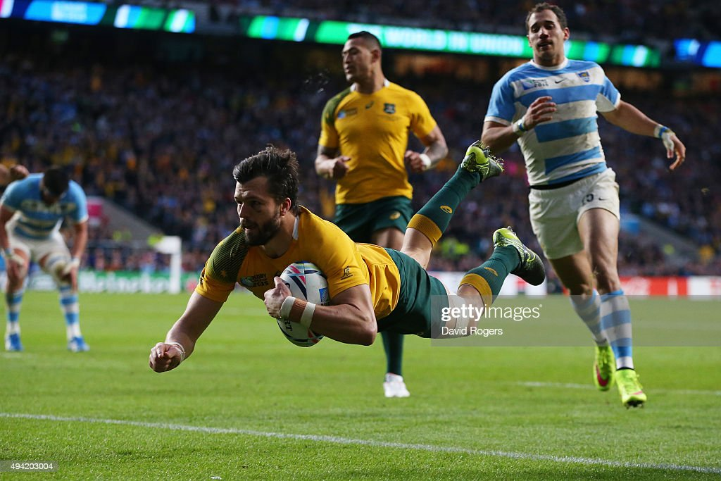 <a gi-track='captionPersonalityLinkClicked' href=/galleries/search?phrase=Adam+Ashley-Cooper&family=editorial&specificpeople=637621 ng-click='$event.stopPropagation()'>Adam Ashley-Cooper</a> of Australia dives over to score his sides third try during the 2015 Rugby World Cup Semi Final match between Argentina and Australia at Twickenham Stadium on October 25, 2015 in London, United Kingdom.