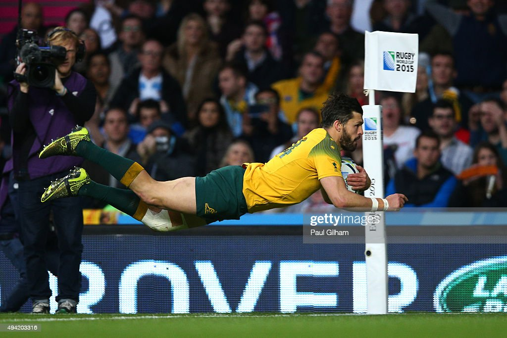 Adam AshleyCooper of Australia dives over to score his sides third try during the 2015 Rugby World Cup Semi Final match between Argentina and...