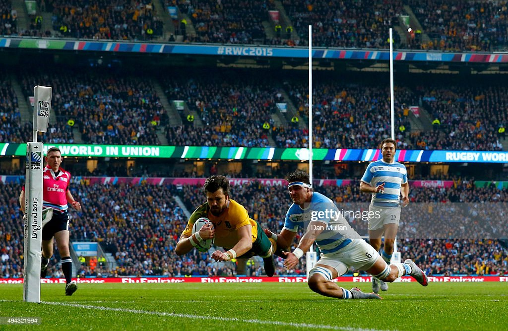 Adam Ashley-Cooper of Australia dives over to score their second try despite the tackle by Pablo Matera of Argentina during the 2015 Rugby World Cup Semi Final match between Argentina and Australia at Twickenham Stadium on October 25, 2015 in London, United Kingdom.