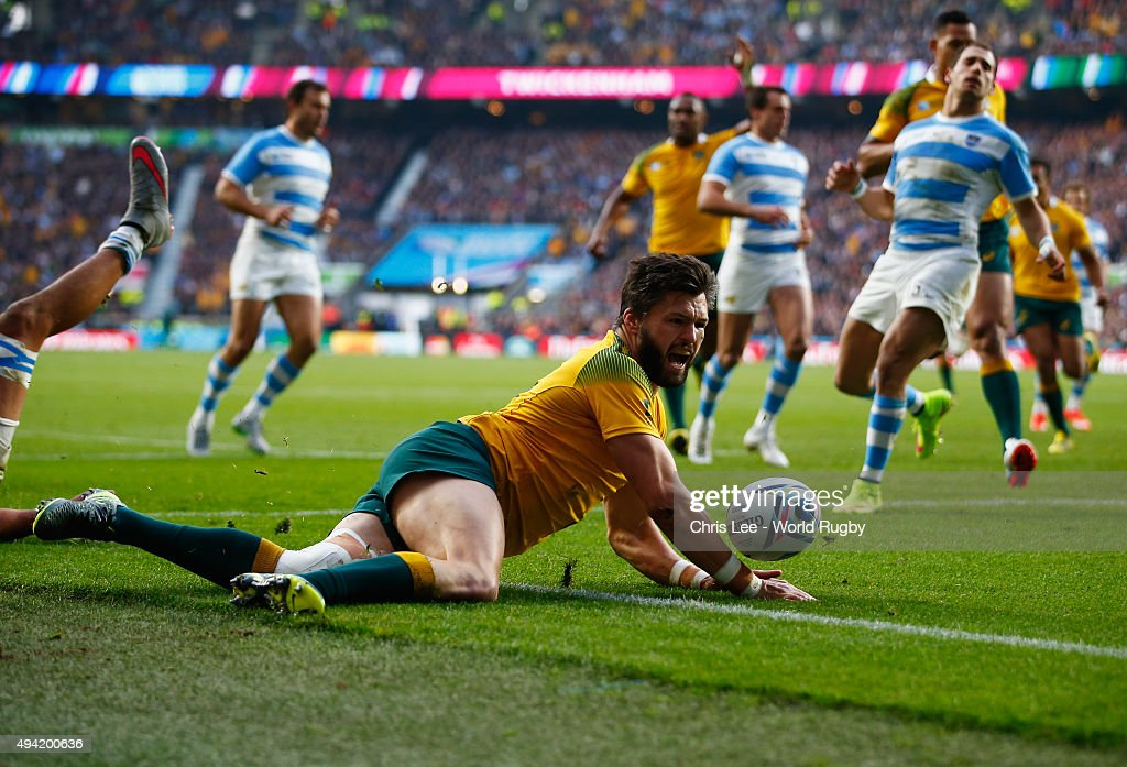 Adam Ashley-Cooper of Australia goes over to score second first try during the 2015 Rugby World Cup Semi Final match between Argentina and Australia at Twickenham Stadium on October 25, 2015 in London, United Kingdom.