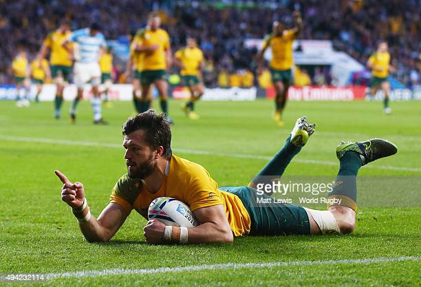 Adam AshleyCooper of Australia goes over to score their third try during the 2015 Rugby World Cup Semi Final match between Argentina and Australia at...