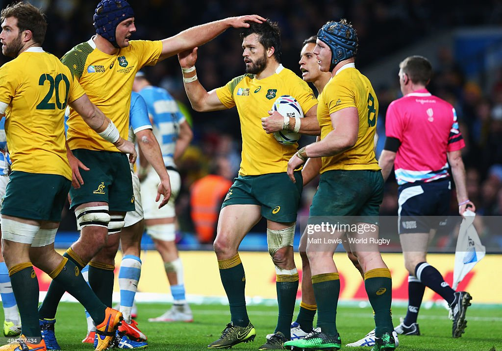 Adam Ashley-Cooper of Australia is congratulated by team mates on scoring their fourth try and his hat trick during the 2015 Rugby World Cup Semi Final match between Argentina and Australia at Twickenham Stadium on October 25, 2015 in London, United Kingdom.